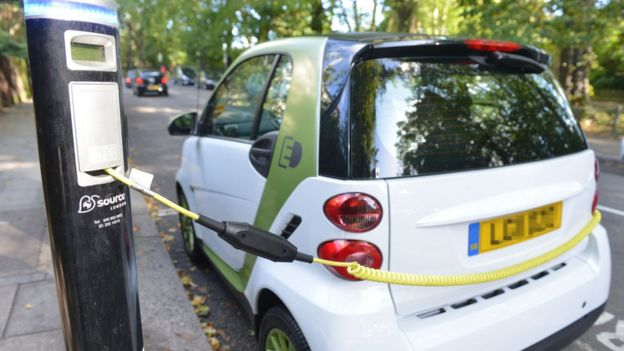 A small electric car charging in London