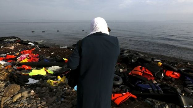 A Syrian woman talks to relatives on her mobile after arriving by sea on the Greek island of Lesbos 21/10/2015