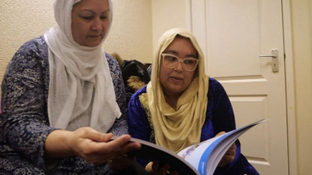 Ayesha Abdol-Hamid and her mum Shahida reading literature in the MEND office