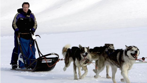David Cameron driving a dog-sled on his way to the Scott-Turner glacier on the island of Svalbard, Norway in 2006