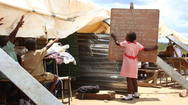 Primary students take lessons under a makeshift classroom because of lack of proper classrooms at the Eastview School in Caledonia, Harare, Zimbabwe, 14 March 2016.