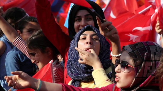 Supporters of Turkish President Tayyip Erdogan react during an election rally in Diyarbakir, Turkey June 3, 2018