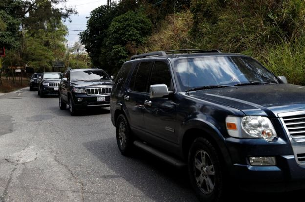 A group of vehicles are driven on the road after leaving the house of the Venezuelan opposition leader Juan Guaido in Caracas, 21 February 2019