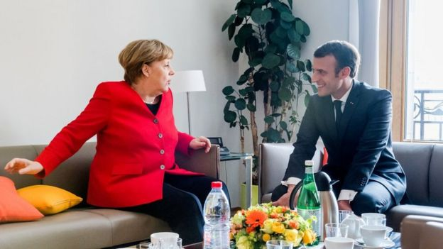 French President Emmanuel Macron and German Chancellor Angela Merkel meet on the sidelines of an EU summit in Brussels
