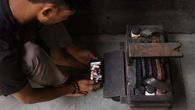 Representational image - A man in Delhi watches a movie on his smartphone
