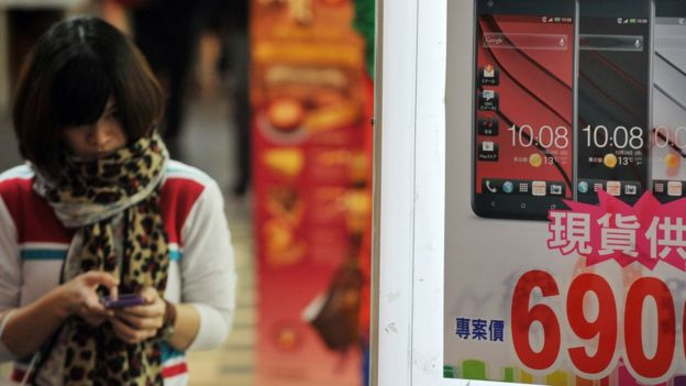 Woman uses mobile phone in Taiwan