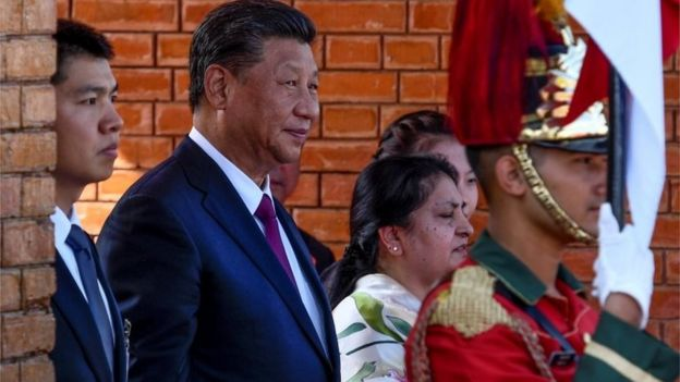 """China's President Xi Jinping and Nepal""""'s President Bidhya Devi Bhandari arrive at Tribhuvan International Airport, as Xi is about to leave, wrapping up his two-day visit to Nepal, in Kathmandu October 13, 2019."""