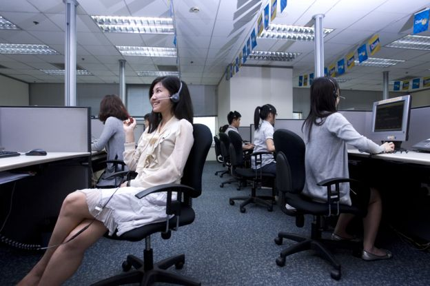 Employees of a call center in the middle of their working day.
