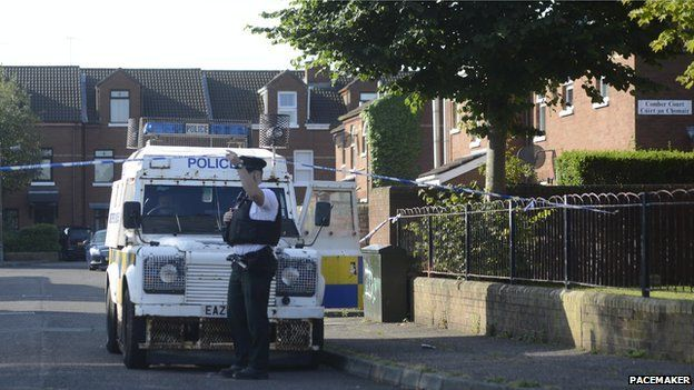 Police cordon at murder scene in Comber Court