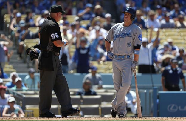Aaron Hill was taken out by umpire Tim Timmons