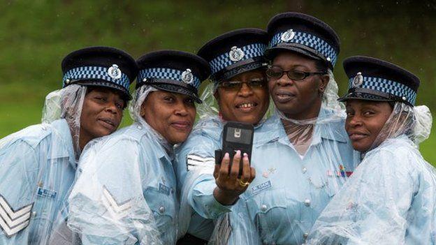Police woman take a selfie photograph