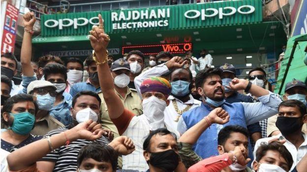 "Chief of Gujarat""d Karni Sena Raj Shekhawat (wearing turban C) along with activists shout slogans during an anti-China demonstration at a commercial area in Ahmedabad on June 24, 2020"