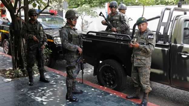 Members of the Guatemalan Military Police stand guard outside a hotel in Guatemala City, Guatemala, July 31, 201