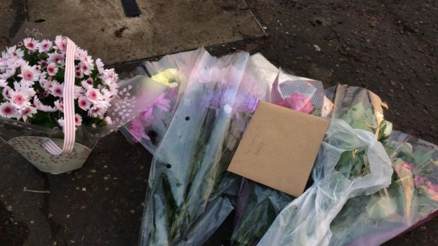 Flowers and messages at the scene