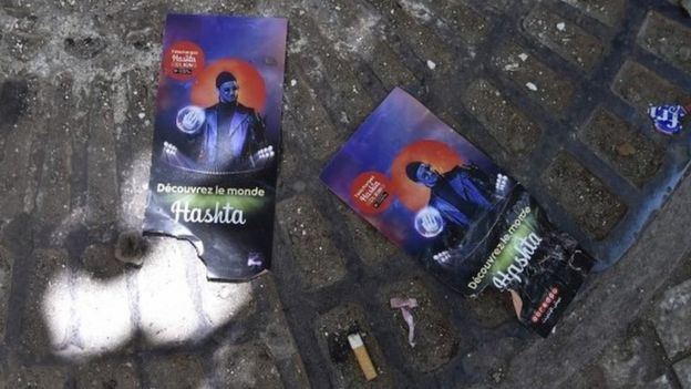 "A picture shows on August 23, 2019, flyers of rapper Soolking lying on the ground outside Algiers"" August-20 Stadium where five young people were killed and dozens more injured in a stampede at a packed concert by the musician the previous night."