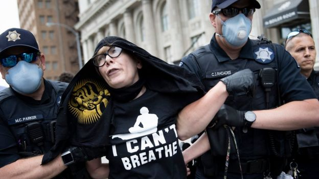 A protester is removed by police from an area near where Donald Trump will hold a rally in Tulsa, Oklahoma (20 June 2020)