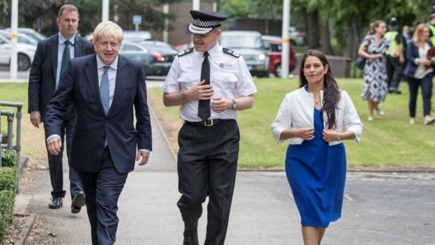 Britain's Prime Minister Boris Johnson and Home Secretary Priti Patel with Chief Constable Dave Thompson meet graduates from a West Midlands Police training centre in Birmingham