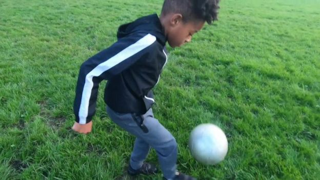 Nai'm playing football