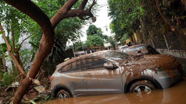 Cars damaged by floods following heavy rains sit in floodwater at a residential area in Bintaro, Jakarta, Indonesia, January 3 2020