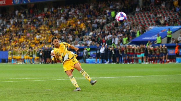 Matildas footballer Sam Kerr kicks a ball on the field at a World Cup game against Norway