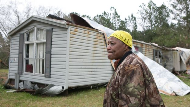 resident views their ruined home