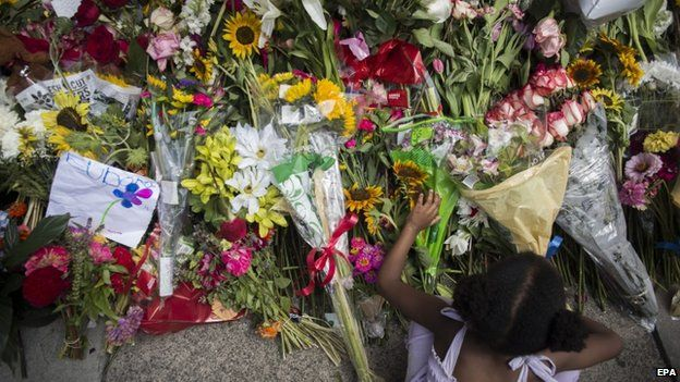 People mourn at the memorial site outside the Emanuel African Methodist Episcopal (AME) Church on 20 June 2015.