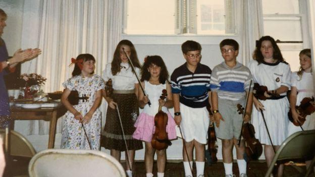 辛德曼(左三)学过小提琴