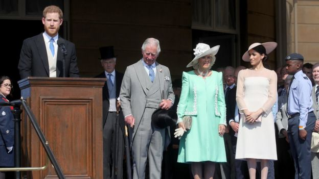 Prince Harry took to the podium to make a speech as his wife, father and the Duchess of Cornwall looked on