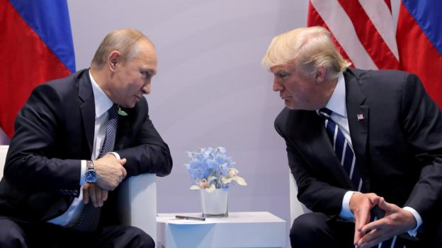 "Russia""s President Vladimir Putin talks to U.S. President Donald Trump during their bilateral meeting at the G20 summit in Hamburg, Germany, July 7, 2017."