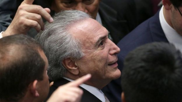 Brazil's President Michel Temer looks at the the people in the galleries as he arrives to take the presidential oath at the National Congress, in Brasilia,