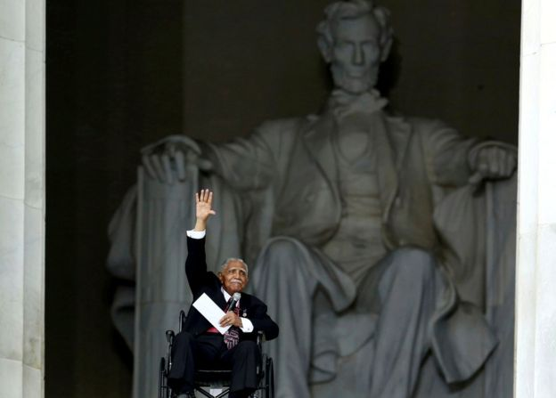Joseph Lowery waves after his speech at the Lincoln Memorial during the 50th anniversary ceremonies of the 1963 March on Washington, 28 August 2013