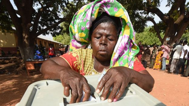 A woman casts her ballot for the presidential election at a polling station in Bole district, northern Ghana, on December 7, 2016