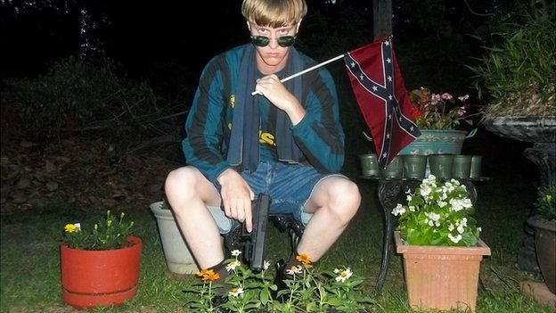 An image appearing to show Charleston church shooting suspect Dylann Roof posing with a Confederate flag and a handgun - 27 April 2015