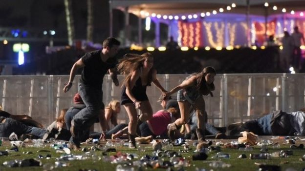 Concert-goers running or covers during the shooting in Las Vegas