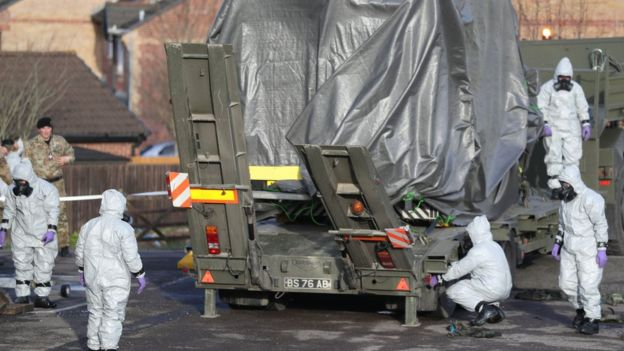 Military personnel remove an ambulance from the scene
