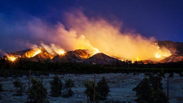 The Thomas Fire burns along a hillside near Santa Paula, California, on 5 December 2017