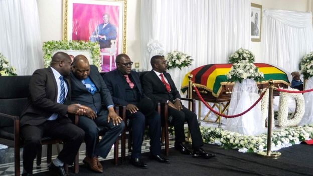 "Movement for Democratic Change party leader Nelson Chamisa (R), vice-president Tendai Biti (2ndR) and vice-Chairman Job Sikhala (2ndL) attend the lying in state of Zimbabwe""s late president Robert Mugabe at the Mugabe""s Blue Roof residency in Harare on September 12, 2019"