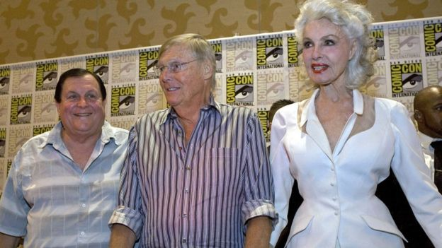 Original actors in the 1960s television series, Batman, (L-R) Burt Ward, Adam West, and Julie Newmar at Comic-Con 2014 in San Diego, California