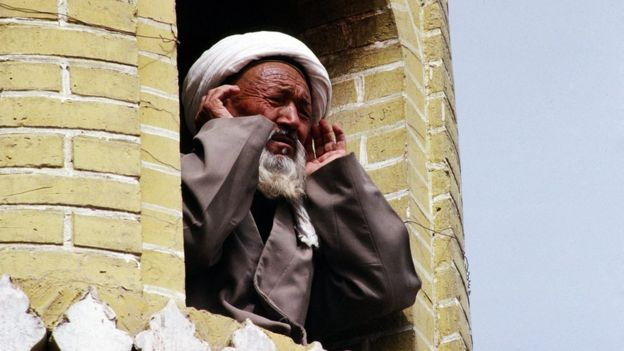 A Muslim man leads the call to prayer in Kashgar, in China's Xinjiang province