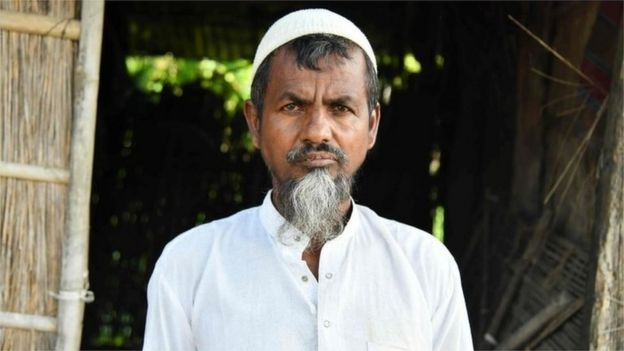 In this photo taken on August 29, 2019, Saheb Ali, 55, poses for a photograph at his home in Khutamari village in Goalpara district, some 160km from Guwahati, the capital city of India's north-eastern state of Assam