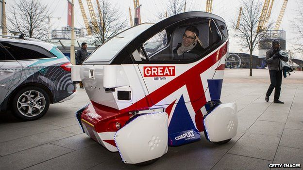 A driverless vehicle known as a Lutz 'Pathfinder' Pod during a photocall in central London on 11 February, 2015
