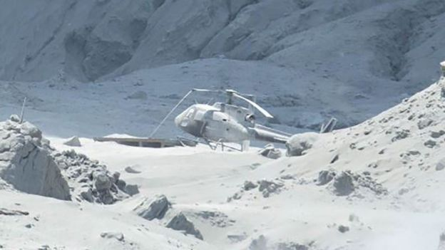 Helicopter covered in ash on White Island, 9 December