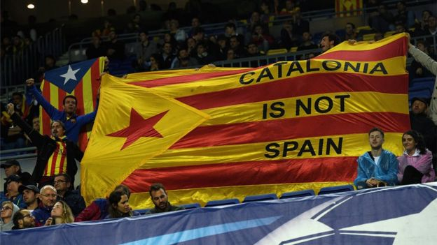 A Catalonia protest poster is shown during the UEFA Champions League group D match between FC Barcelona and Olympiakos Piraeus at Camp Nou on October 18, 2017 in Barcelona