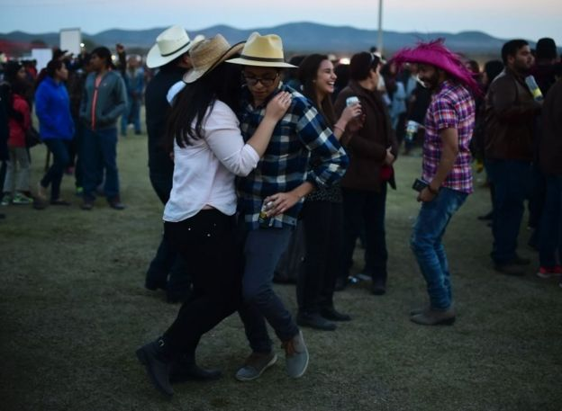 People attend the 15th birthday party celebrations of Rubi Ibarra on December 26, 2016 in Villa Guadalupe, San Luis Potosi State, Mexico