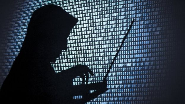 A silhouette of a hacker.