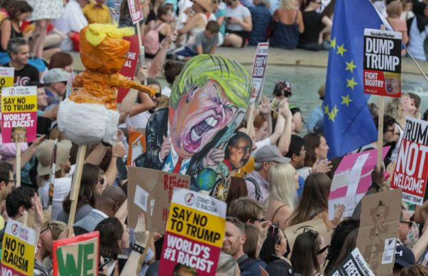 Demonstrators are seen during a demonstration against the visit to the UK by US President Donald Trump on July 13, 2018 in London