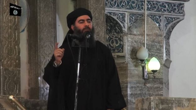 Abu Bakr al-Baghdadi addresses worshippers at the Great Mosque of al-Nuri in Mosul, Iraq, on 5 July 2014