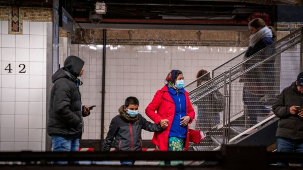 Travellers wear medical masks at Grand Central station on March 5, 2020 in New York City