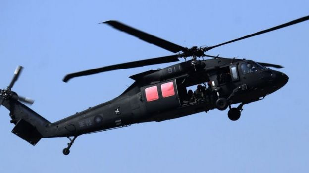A mannnequin is thrown from a US-made Black Hawk helicopter during an annual military drill in Taichung, central Taiwan, on January 17, 2017.