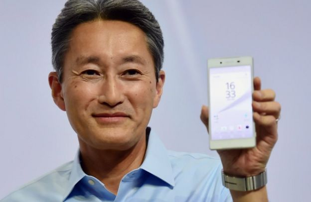 Kazuo Hirai holds up a Sony Xperia phone
